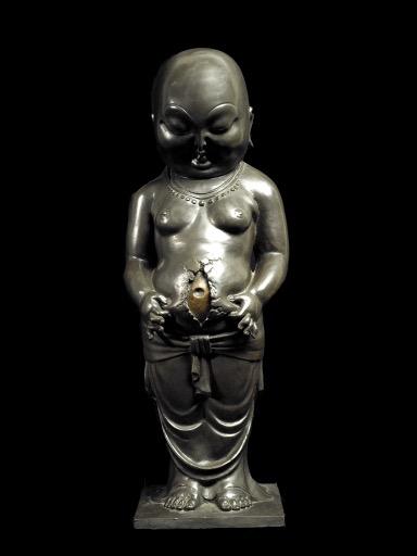 Фигура стоящего монаха